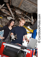 Mechanic with Skeptical Customer - Concentrated man and...