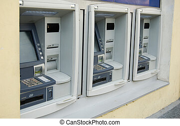 Three cash dispenses nearby. Bank service.