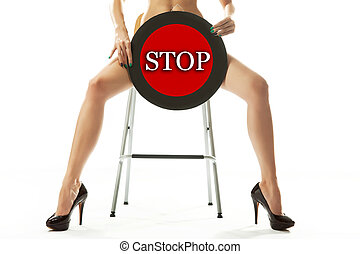 Conceptual photo of a woman holding stop sign
