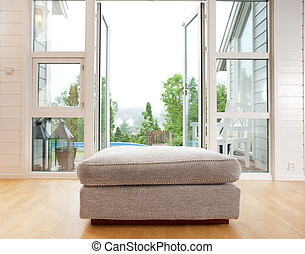 Indoor With Large Outdoor View - A large chair cushion in...