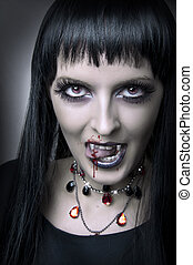Fashion portrait of woman vampire