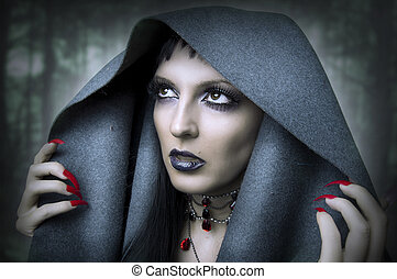 Fashion portrait of young beauty woman - witch in dark...