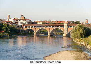 Pavia (Lombardy, Italy) and the covered bridge over the...