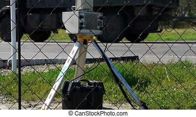 speed camera at the side of the road with blurred cars...