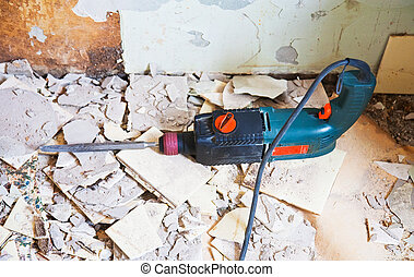 Repair in apartment. The electric drill lies on a floor
