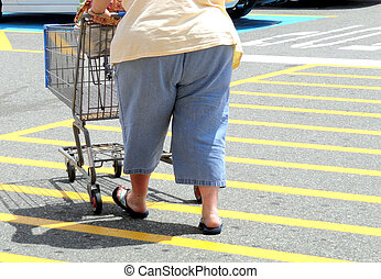 Overweight woman. - Overweight woman walking to her car.