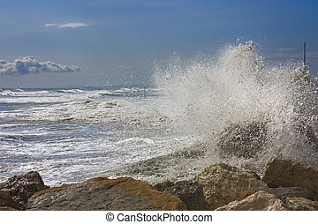 waves - sea surf waves breaking over the cliff of italian...