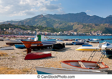 boats on beach Giardini Naxos in summer day, Sicily -...