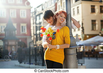 Young couple with flowers, outdoors
