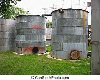 Old industrial rusty tanks for chemicals at an power plant