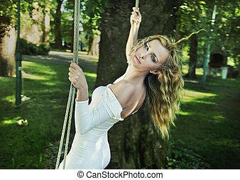 Beauty woman in garden