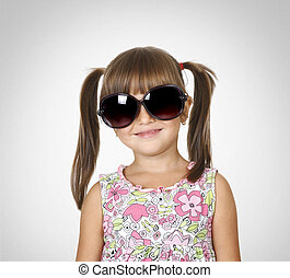 little girl in big glasses - Portrait of smilling little...