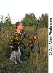 Hunting. - Man in camouflage with a gun and russian hunting...