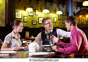 At a restaurant - Young people having dinner at a restaurant
