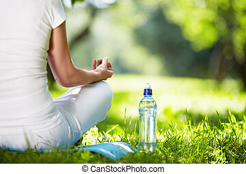 Yoga - Woman in lotus position close-up