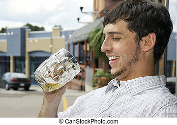 Happy drinking young guy - Young man or student happy to...
