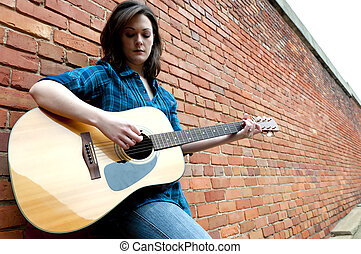 Young Woman Playing Guitar - Young woman playing guitar...