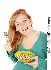 Teenage girl with a bowl of cereal