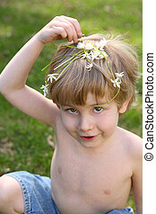 Young child playing with flowers