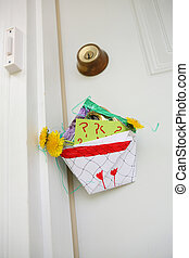 Homemade basket of flowers hanging on a door