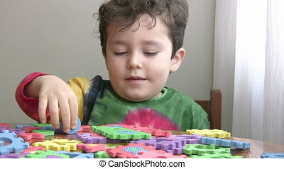 Little Boy Playing educational Toy - Little Boy Playing and...