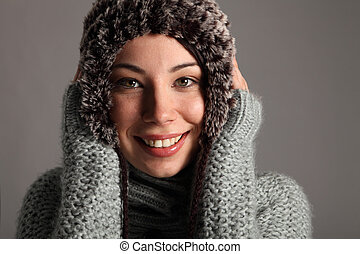 Beautiful young girl in winter wool jumper and hat