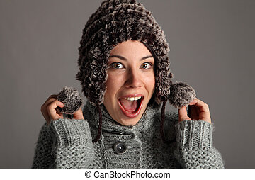 Excited happy young girl in warm winter wool hat - Excited...