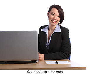 Beautiful happy young business woman in office