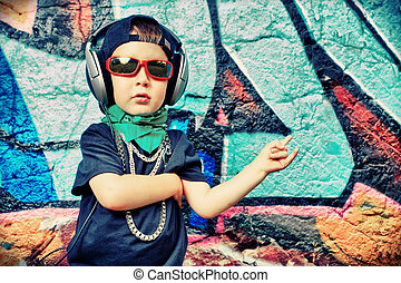 trendy kid - Portrait of a trendy little boy with headphones...