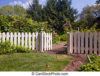 Entrance to kitchen garden - White picket fence and gate...