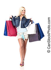 Shopping - Young blond lady holding shopping bags isolated...