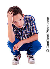 young man squatting, worried, isolated on white background...