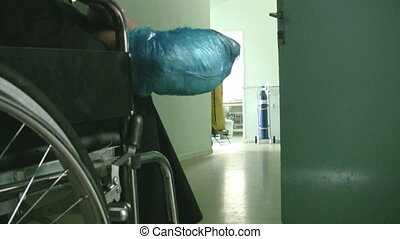 Woman in wheelchair - Patient women waiting the doctor
