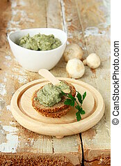 pate of mushrooms on a wooden table