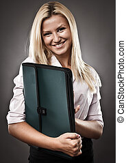 Attractive businesswoman with folder