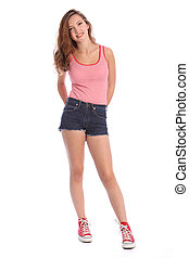 Teenager girl in denim shorts and vest happy smile - Pretty...