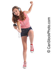 Fun teenage girl dancing with energy to music - Happy...