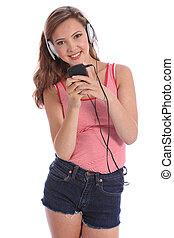 Happy beautiful teenage girl music on headphones - Enjoying...