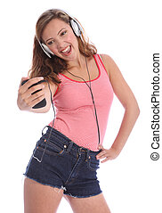Teenage girl singing to music from her cell phone - Enjoying...