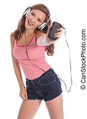 Teenage girl dances to music from mobile phone - Enjoying...
