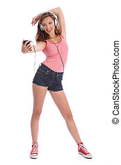 Happy long legged teenage girl has fun with music - Pretty...
