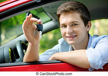 drivers license - teenager sitting in new car and shows the...