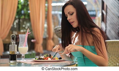 lunch at a restaurant - attractive young woman in a cocktail...