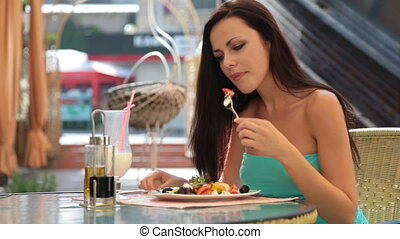 young woman having dinner at a restaurant Her choice Greek...