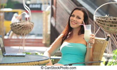 Brunette drinking milk shake - Beautiful Brunette drinking...