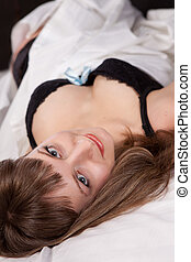 girl laying on bed wearing black