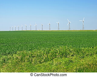Raw of wind-turbines on a green field