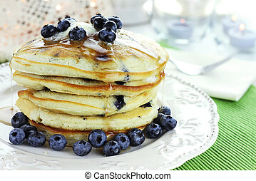 Blueberry Pancakes - Stack of fresh pancakes dripping with...