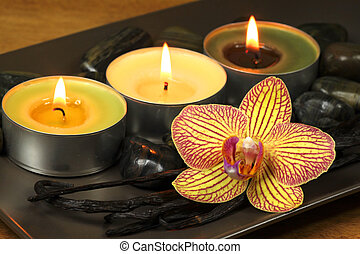 Vanilla and apple aromatherapy - Three burning candles and...