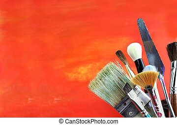 Paintbrushes against a grunge background.